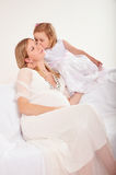 Young pregnant woman with little daughter Royalty Free Stock Images