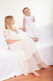 Young pregnant woman with little daughter Stock Image