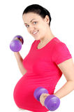Young pregnant woman making exercise Stock Images
