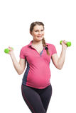 Young pregnant woman making exercise with dumb Stock Image