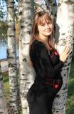 Young pregnant woman near birch Stock Photos