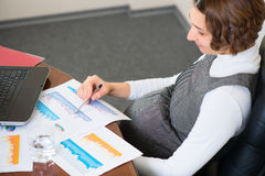 Young pregnant woman at office Royalty Free Stock Photo