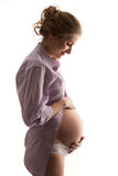 Young pregnant woman over white Royalty Free Stock Images