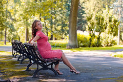 Young pregnant woman in park Royalty Free Stock Photos