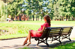 Young pregnant woman in park Stock Photo