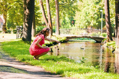 Young pregnant woman in park Royalty Free Stock Photography