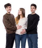 Young pregnant woman posing with two young man Royalty Free Stock Photos