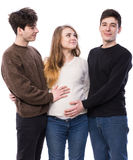 Young pregnant woman posing with two young man Stock Photo