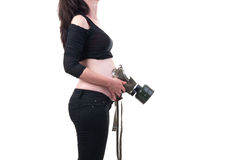 Young pregnant woman put on belly a gas mask to protect the chil Stock Photos
