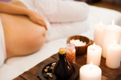 Young pregnant woman relaxing at Spa salon, Spa treatment Royalty Free Stock Image