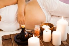 Young pregnant woman relaxing at Spa salon, Spa treatment. Ð¡oncept of beauty and health stock photography
