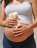 Young pregnant woman on request, rent belly. Custom pregnant woman with money paid by a childless couple, surrogacy stock images
