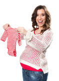 Young pregnant woman with romper. Young pregnant woman with a red romper Stock Image