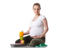 Young  pregnant woman with scales. Stock Photo