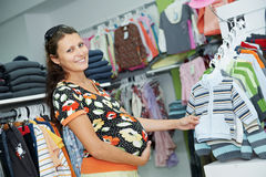 Young pregnant woman at shop Royalty Free Stock Photo