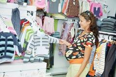 Young pregnant woman at shop Royalty Free Stock Photos