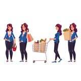 Young pregnant woman with shopping bags, basket, cart Royalty Free Stock Photos