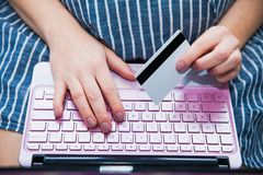 Young pregnant woman shopping online with laptop credit card close-up. Preparations before baby birth Royalty Free Stock Photography