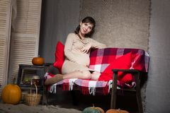 Young pregnant woman sitting on sofa Royalty Free Stock Photo