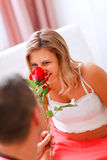 Young pregnant woman smelling flower Royalty Free Stock Photo