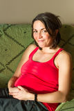 Young pregnant woman smiling Stock Photography