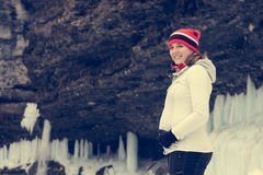 Young pregnant woman smiling on winter landscape. Royalty Free Stock Photography