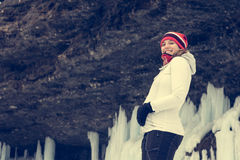 Young pregnant woman smiling on winter landscape. Royalty Free Stock Image