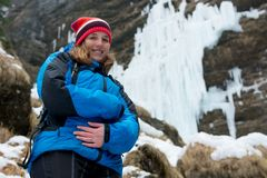 Young pregnant woman smiling on winter landscape. Motherly love Royalty Free Stock Images