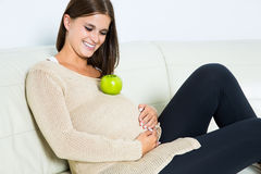 Young pregnant woman. On sofa Stock Photo