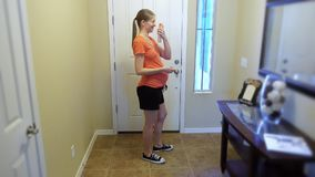 Young Pregnant Woman Sprays Bug Spray on Herself Before Going Outdoors. To help protect herself and her unborn baby from mosquitoes and the Zika virus, a young stock video