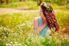 Young pregnant woman in spring field of blossoming daisies Stock Photography