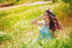 Young pregnant woman in spring field of blossoming daisies Royalty Free Stock Image