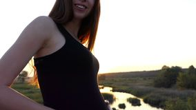 Young pregnant woman at sunset toucing her future baby. Beautiful action stock video footage