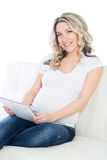 Young pregnant woman with a tablet Stock Photo