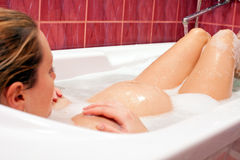 Young pregnant woman taking a bath Royalty Free Stock Images