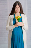 Young pregnant woman in a turquoise dress Stock Images