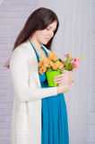 Young pregnant woman in a turquoise dress Royalty Free Stock Image