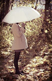 Young pregnant woman under umbrella Stock Images