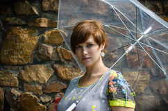 Young pregnant woman under umbrella Stock Photo