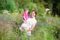 Young pregnant woman walking with her baby Royalty Free Stock Photography
