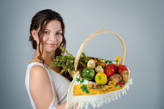 Young pregnant woman with wicker basket harvest. Royalty Free Stock Images