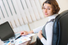 Young pregnant woman working at office Stock Image