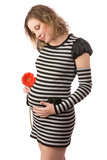 Young pregnant women with the red flower Stock Photos