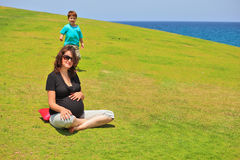 The pregnant woman and her young son Royalty Free Stock Photo