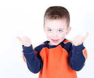 Young preschool age boy with thumbs up. On white background Royalty Free Stock Photography