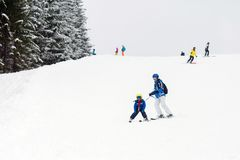 Young child, skiing on snow slope in ski resort in Austria royalty free stock images