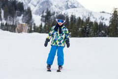 Young child, skiing on snow slope in ski resort in Austria Royalty Free Stock Image