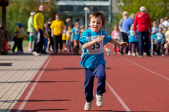 Young preschool children, running on track in a marathon competition Royalty Free Stock Image