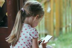 Young preschooler using smartphone Royalty Free Stock Photos