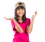 Young Preteen Asian Girl With A Cap IX. Young preteen Asian girl with a cap over white background Royalty Free Stock Photography
